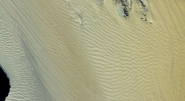 This image, acquired by NASA's Terra spacecraft, shows the Namib Desert, a coastal desert in southern Africa. This portion in central Namibia consists entirely of linear and longitudinal sand dunes.