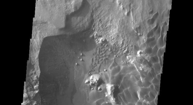 This image captured by NASA's 2001 Mars Odyssey spacecraft shows part of the sand sheet and dunes on the floor of Rabe Crater.