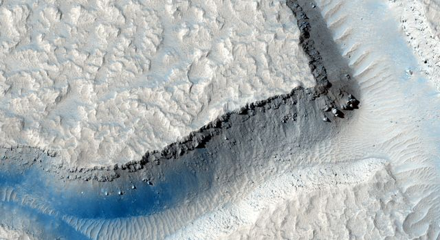 In this image from NASA's Mars Reconnaissance Orbiter, we see an intersection of several fractures on the floor of Echus Chasma. One 'sector' appears to have been filled by a more recent viscous lava flow.