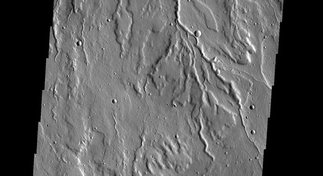 This image shows part of Rubicon Valles located on the northwestern flank of Alba Mons seen by NASA's 2001 Mars Odyssey spacecraft.