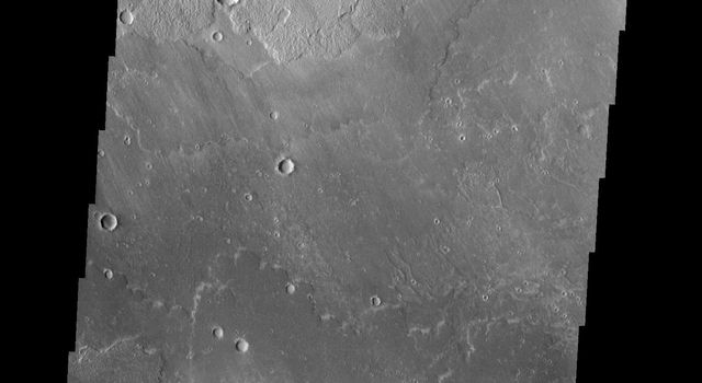 The channel in the bottom part of this image captured by NASA's 2001 Mars Odyssey spacecraft was created by lava flow rather than water flow. This feature is located in the Tharsis plains east of Olympus Mons.