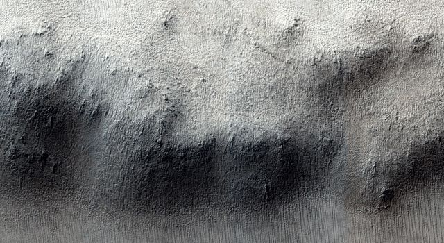 These craters on Tharsis are first visible as new dark spots observed by NASA's Mars Reconnaissance Orbiter's Context Camera (CTX), which can view much larger areas, and then imaged by HiRISE for a close-up look.