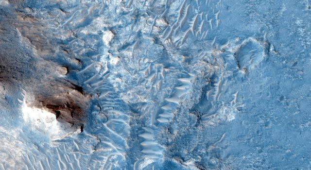 In the area between Crommelin and Firsoff craters, NASA's Mars Reconnaissance Orbiter saw heavily cratered terrain with deposits that record Martian geologic history and stratigraphy.