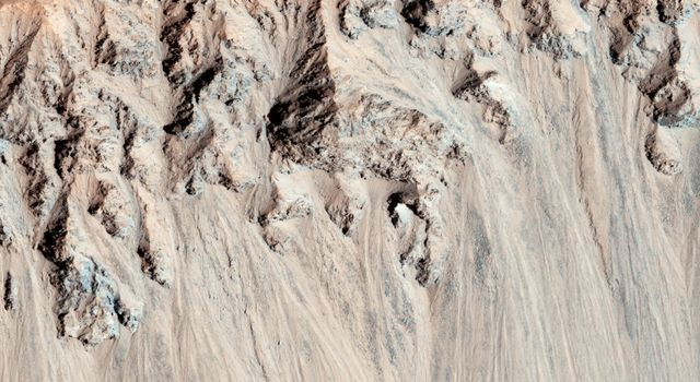 This well-preserved impact crater in Tyrrhena Terra, northeast of Hellas Planitia, is approximately 6 kilometers in diameter as seen by NASA's Mars Reconnaissance Orbiter.