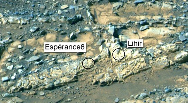 Rock targets known as 'Esperance6,' and 'Lihir,' are shown in this false-color view from NASA's Mars Exploration Rover Opportunity. Esperance6 was deeply abraded with the rover's rock abrasion tool.