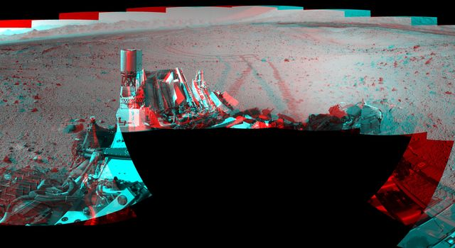 This stereo mosaic of images from NASA's Mars rover Curiosity shows the terrain surrounding the rover's position on the 524th Martian day. You need 3-D glasses to view this image.