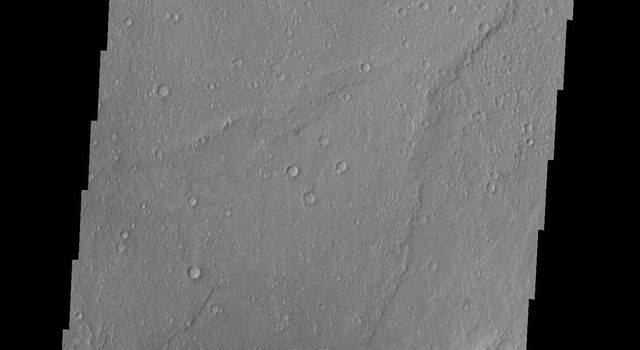 The small, dark sand dunes at the bottom of this image captured by NASA's 2001 Mars Odyssey spacecraft are located on the floor of Escalante Crater.
