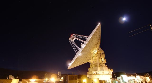 Late night in the desert: Goldstone's 230-foot (70-meter) antenna tracks spacecraft day and night. This photograph was taken on Jan. 11, 2012. The Goldstone Deep Space Communications Complex is located in the Mojave Desert in California, USA.