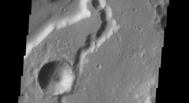 This image from NASA's 2001 Mars Odyssey spacecraft shows a portion of Nanedi Valles.