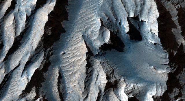 This observation from NASA's Mars Reconnaissance Orbiter is of an east-facing slope in Tithonium Chasma.