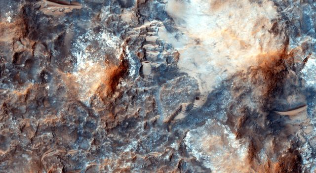 'Megabreccia' is a term used to describe jumbled, fragmented blocks of rock larger than 1 meter (1.09 yard) across. This image was observed by NASA's Mars Reconnaissance Orbiter.