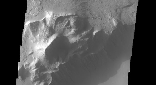 This image captured by NASA's 2001 Mars Odyssey spacecraft shows part of the escarpment that encircles Olympus Mons. This image is located on the southeastern flank of the volcano.