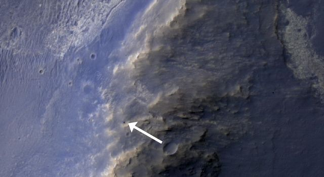 This HiRISE image of the Opportunity rover was acquired as a coordinated 'ride-along' observation with the CRISM instrument, also onboard the Mars Reconnaissance Orbiter.