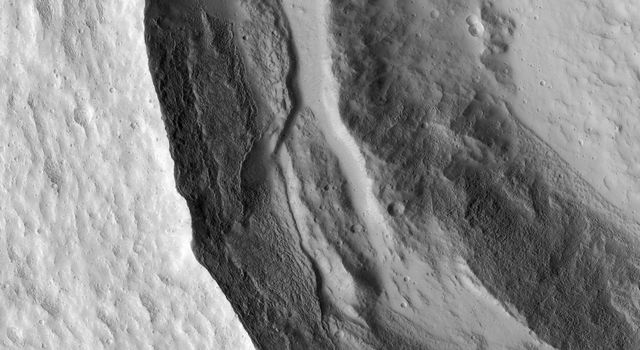 This image from NASA's Mars Reconnaissance Orbiter shows the western rim of a well-preserved 8.5-kilometer (about 5 miles) diameter impact crater.