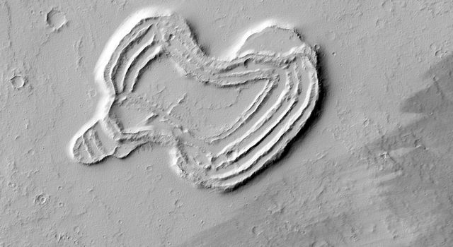 This feature from NASA's Mars Reconnaissance Orbiter looks like a heart. It is located south of Ascraeus Mons, which is a large volcano within the Tharsis volcanic plateau, making it extremely likely that this feature was formed by a volcanic process.