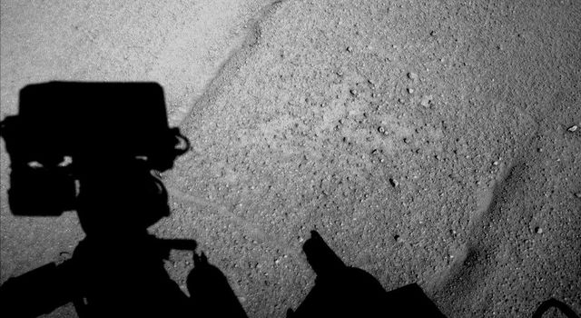 NASA's Curiosity Mars rover caught its own shadow in this image taken just after completing a drive of 329 feet (100.3 meters) on the 547th Martian day, or sol, of the rover's work on Mars (Feb. 18, 2014).