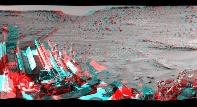 This stereo view combining images taken on Feb. 10, 2014, by the Navigation Camera (Navcam) on NASA's Curiosity Mars rover looks back to where the rover crossed a dune at 'Dingo Gap' four days earlier. You need 3D glasses to view this image.