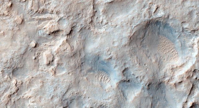 NASA's Mars Reconnaissance Orbiter saw the saddle between two valleys named Dingo Gap-in Gale Crater-where the rover Curiosity just traversed. The gap is spanned by a single dune visible both from the ground and from orbit.