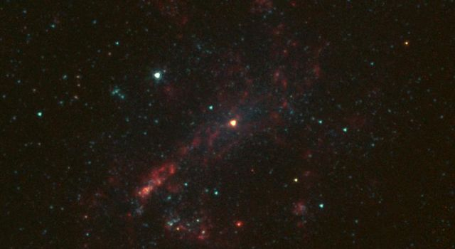 The galaxy NGC 4395 is shown here in infrared light, captured by NASA's Spitzer Space Telescope. This dwarf galaxy is relatively small in comparison with our Milky Way galaxy, which is nearly 1,000 times more massive.