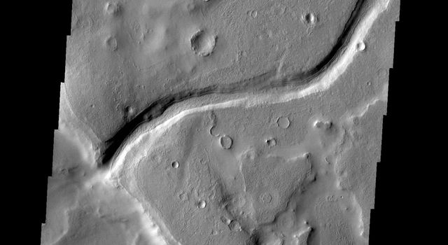 This image from NASA's 2001 Mars Odyssey spacecraft shows a small unnamed channel on the eastern margin of Arabia Terra.
