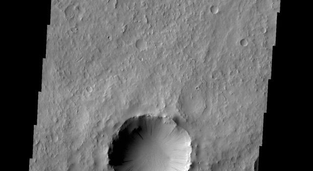 Dark slope streaks are found everywhere on the inner rim of this unnamed crater in Arabia Terra in this image captured by NASA's 2001 Mars Odyssey spacecraft.
