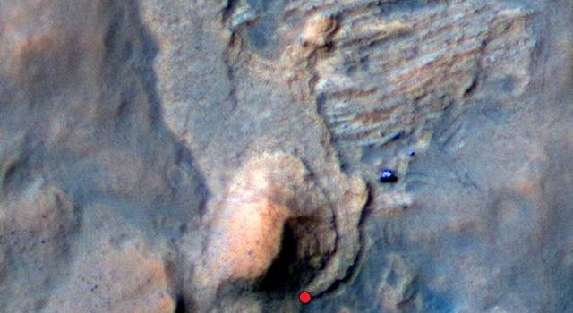 In this Mars Reconnaissance Orbiter view of the Curiosity rover mission's waypoint called 'the Kimberley,' the red dot indicates the location of a sandstone target, 'Windjana,' selected for close-up inspection.