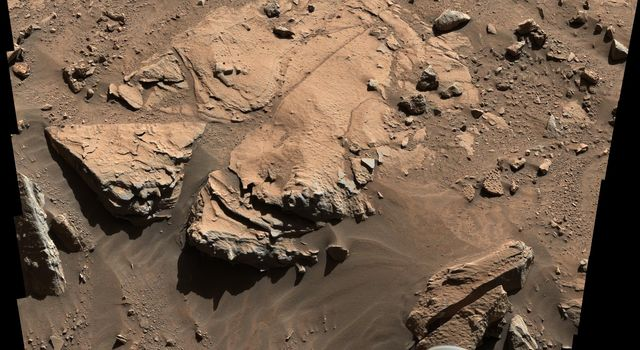 NASA's Curiosity Mars rover has driven within robotic-arm's reach of the sandstone slab at the center of this view.