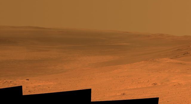 This vista of the Endeavour Crater rim was acquired by NASA's Mars Exploration Rover Opportunity's panoramic camera on April 18, 2014, from the southern end of 'Murray Ridge' on the western rim of the crater.