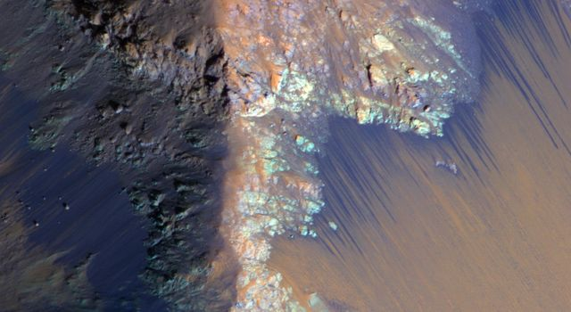 Recurring slope lineae (RSL) may be due to active seeps of water. These dark flows are abundant along the steep slopes of ancient bedrock in Coprates Chasma as seen in this image from NASA's Mars Reconnaissance Orbiter.