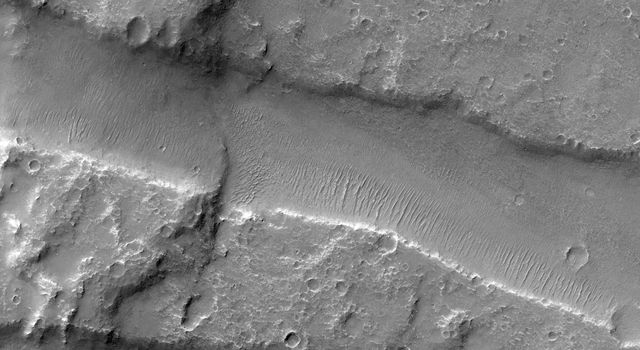 Melas Chasma is part of the Valles Marineris canyon system, the largest canyon in the Solar System. This image was taken by NASA's Mars Reconnaissance Orbiter.