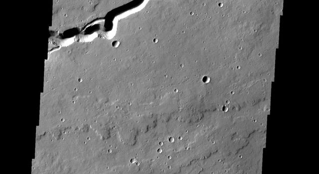 This image captured by NASA's 2001 Mars Odyssey spacecraf shows a portion of Patapsco Vallis, located on the eastern margin of the Elysium volcanic complex.