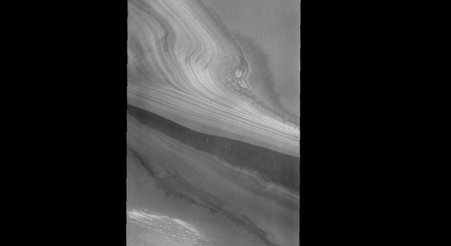 This image as seen by NASA's 2001 Mars Odyssey spacecraft shows the layering of the ice at the north pole.