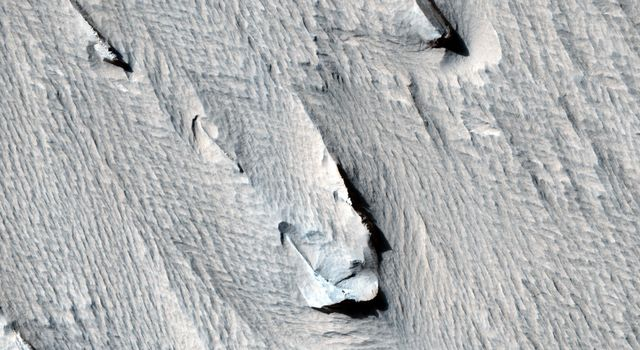 Yardangs are streamlined hills that are carved by wind erosion from bedrock. NASA's Mars Reconnaissance Orbiter viewed these yardangs which can look like the hull of a boat.