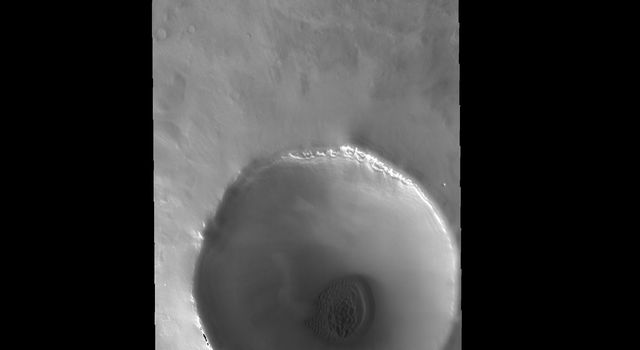 This image captured by NASA's 2001 Mars Odyssey spacecraft shows another unnamed crater near the north pole with dunes on its floor.