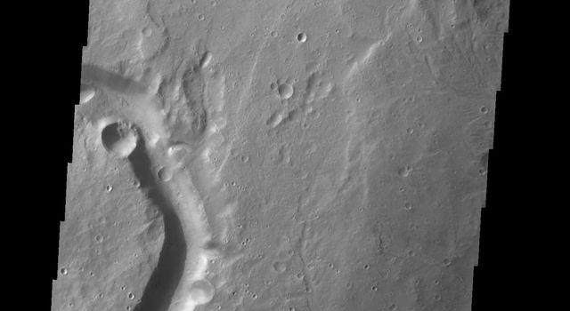 This image captured by NASA's 2001 Mars Odyssey spacecraft shows an unnamed channel located on the northwest margin of Arabia Terra.