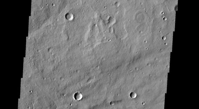 A delta deposit sits on the floor of this unnamed crater in Arabia Terra, as shown in this image from NASA's 2001 Mars Odyssey spacecraft. The channel that created the delta dissects the crater rim.