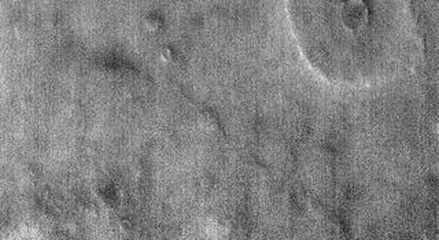 The ejecta pattern around this northern plains crater is termed 'butterfly' for its similarity to butterfly wings, as shown in this image captured by NASA's 2001 Mars Odyssey spacecraft.