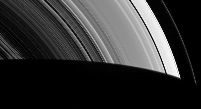 Seen by NASA's Cassini spacecraft within the vast expanse of Saturn's rings, Prometheus appears as little more than a dot. But that little moon still manages to shape the F ring, confining it to its narrow domain.