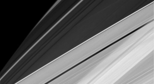Saturn's oblateness, the varying opacity of its rings and the shadows cast by those rings, sometimes creates elaborate and complicated patterns from NASA's Cassini's perspective.