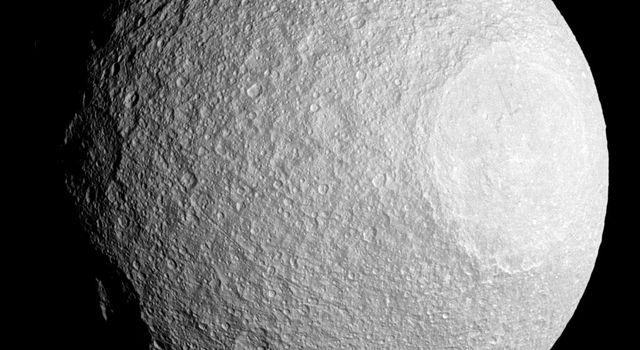 Like most moons in the solar system, Tethys is covered by impact craters. Some craters bear witness to incredibly violent events, such as the crater Odysseus (seen here at the right of this image from NASA's Cassini spacecraft).