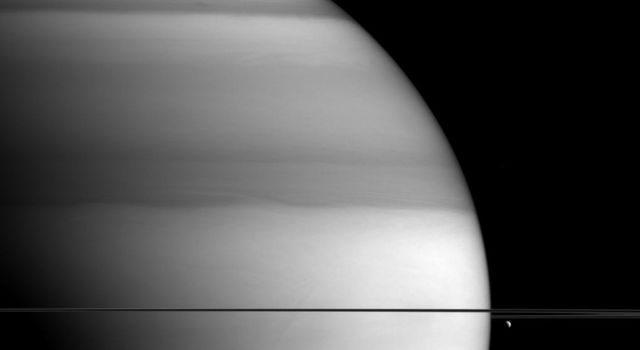 The soft, bright-and-dark bands displayed by Saturn in this view from NASA's Cassini spacecraft are the signature of methane in the planet's atmosphere.