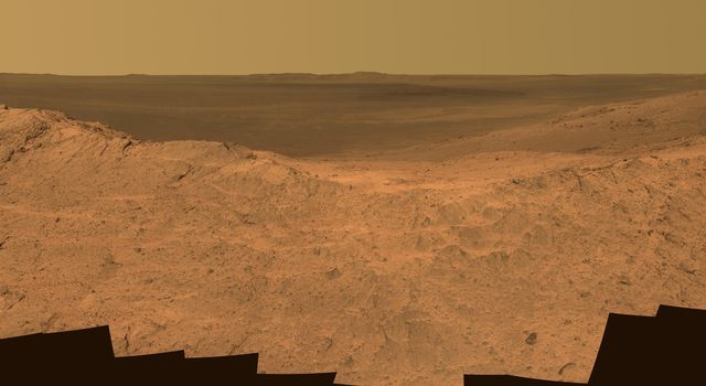 This scene from the panoramic camera (Pancam) on NASA's Mars Exploration Rover Opportunity catches 'Pillinger Point,' on the western rim of Endeavour Crater, in the foreground.