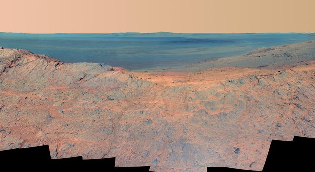 This false-color scene from the panoramic camera (Pancam) on NASA's Mars Exploration Rover Opportunity catches 'Pillinger Point,' on the western rim of Endeavour Crater, in the foreground.