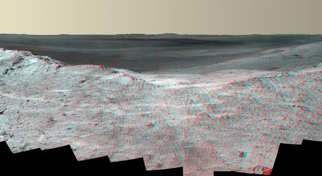 This stereo vista from the panoramic camera (Pancam) of NASA's Mars Exploration Rover Opportunity catches 'Pillinger Point,' on the western rim of Endeavour Crater, in the foreground. You need 3-D glasses to view this image.
