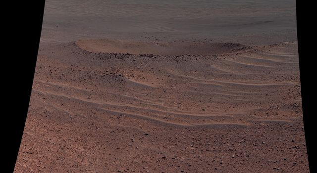 This scene from NASA's Opportunity rover shows 'Lunokhod 2 Crater,' which lies south of 'Solander Point' on the west rim of Endeavour Crater. Lunokhod 2 Crater is approximately 20 feet (6 meters) in diameter.