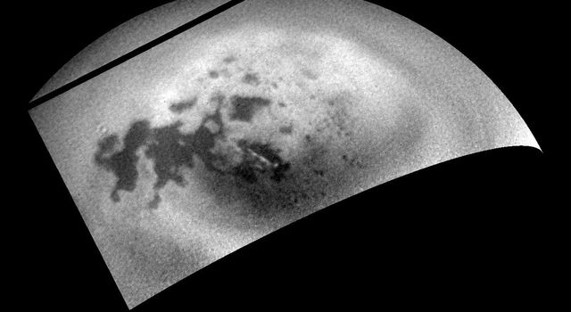 As NASA's Cassini spacecraft sped away from Titan following a relatively close flyby, its cameras monitored the moon's northern polar region, capturing signs of renewed cloud activity.