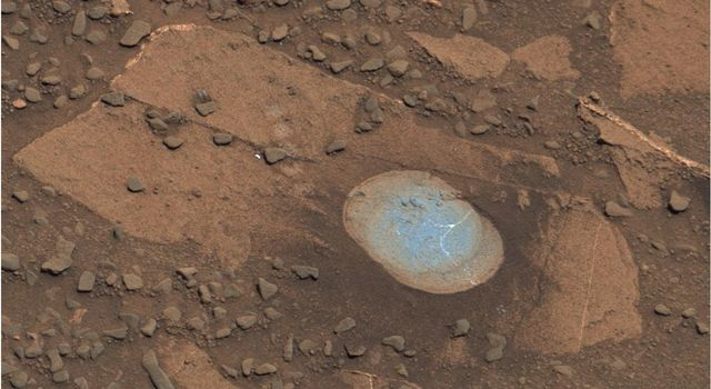 A swept Martian rock called 'Bonanza King' can be seen in this image take by NASA's Mars Curiosity rover. This rock is located across the boundary that defines the base of Mount Sharp.