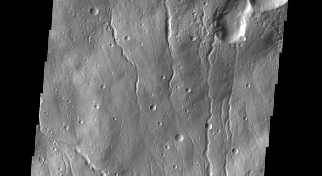 This image captured by NASA's 2001 Mars Odyssey spacecraft shows part of the northern flank of Hecates Tholus, which is located on the northern part of the Elysium Volcanic Complex.