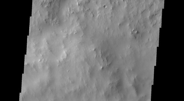Dark slope streaks mark the rim of this unnamed crater in Terra Sabaea, as shown in this image captured by NASA's 2001 Mars Odyssey spacecraft.