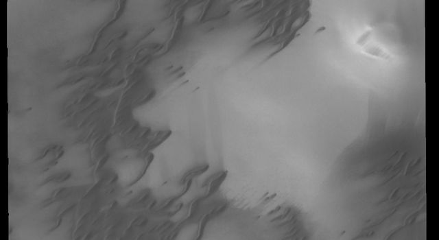 This image captured by NASA's 2001 Mars Odyssey spacecraft shows more north polar dunes.